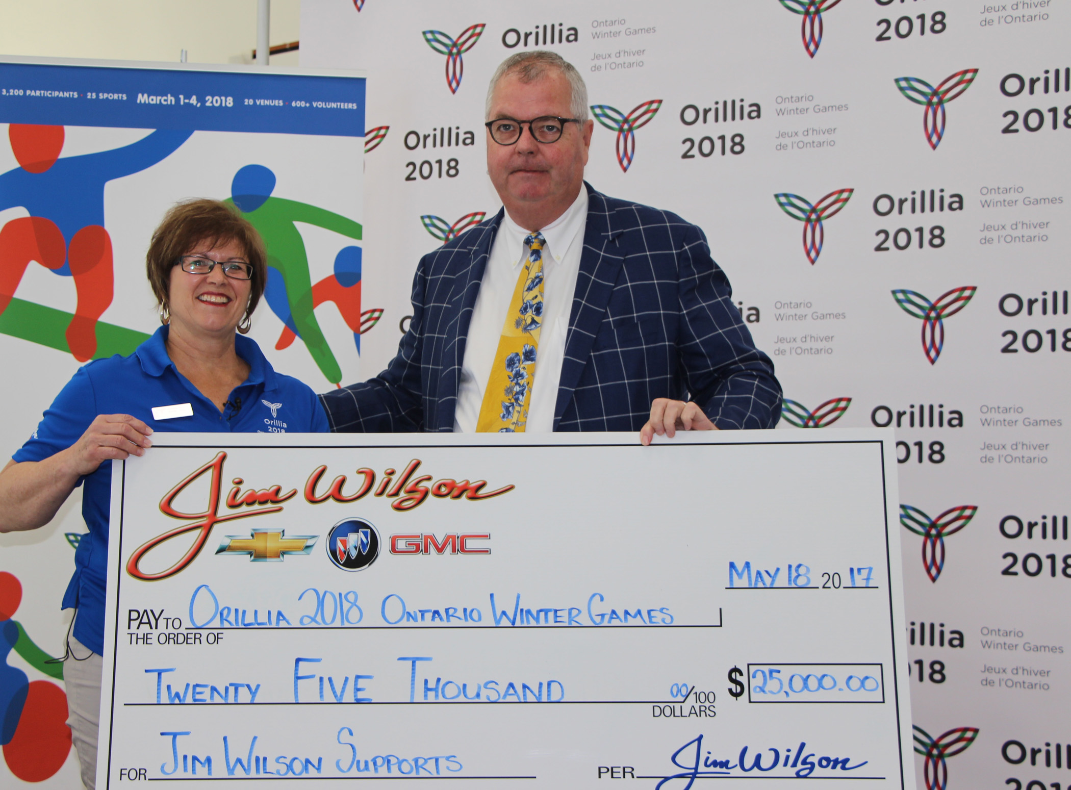 Jim Wilson of Jim Wilson Chevrolet Buick GMC presents a cheque for $25,000 to Orillia 2018 chair, Gill Tillmann, in support of the Ontario Winter Games, to be hosted by the City of Orillia from March 1 – 4, 2018.