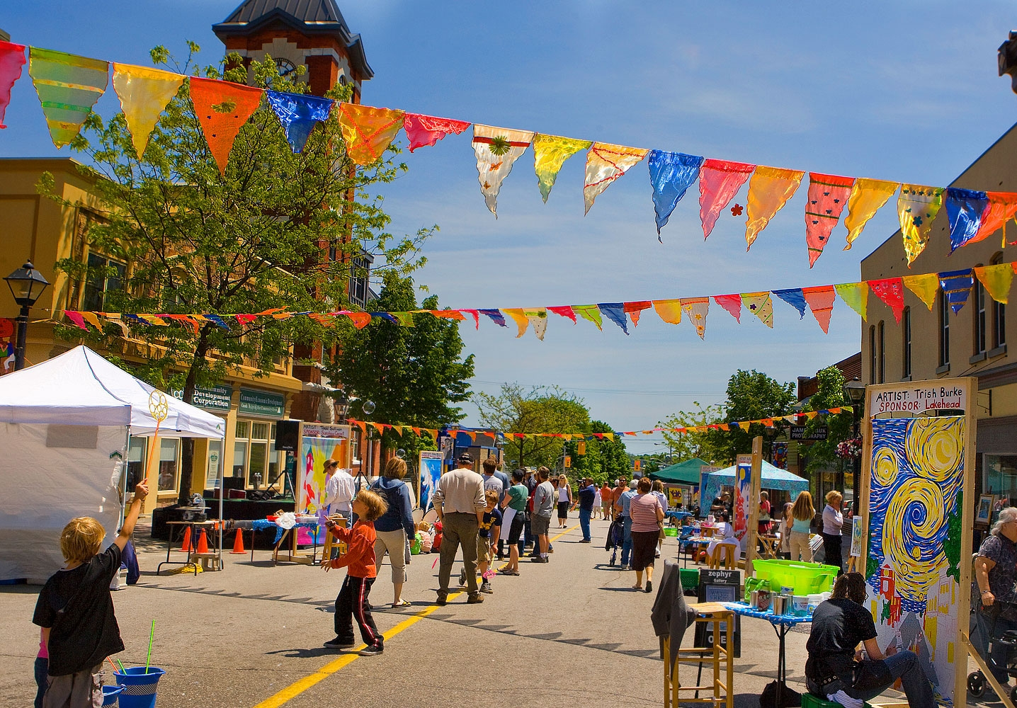 Visitors and residents enjoying a fun and colourful downtown Orillia event.