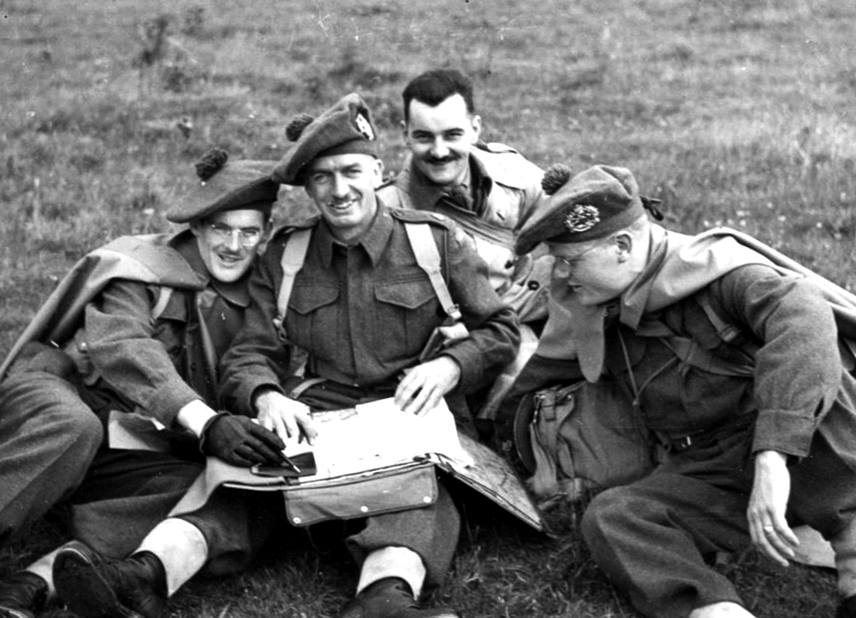 Members of the Lorne Scots Regiment pose for a photo while working, 1942.  Lorne Scots Regimental Museum.