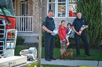 Fire Prevention Division staff at Home Safe Home visit with Milton resident