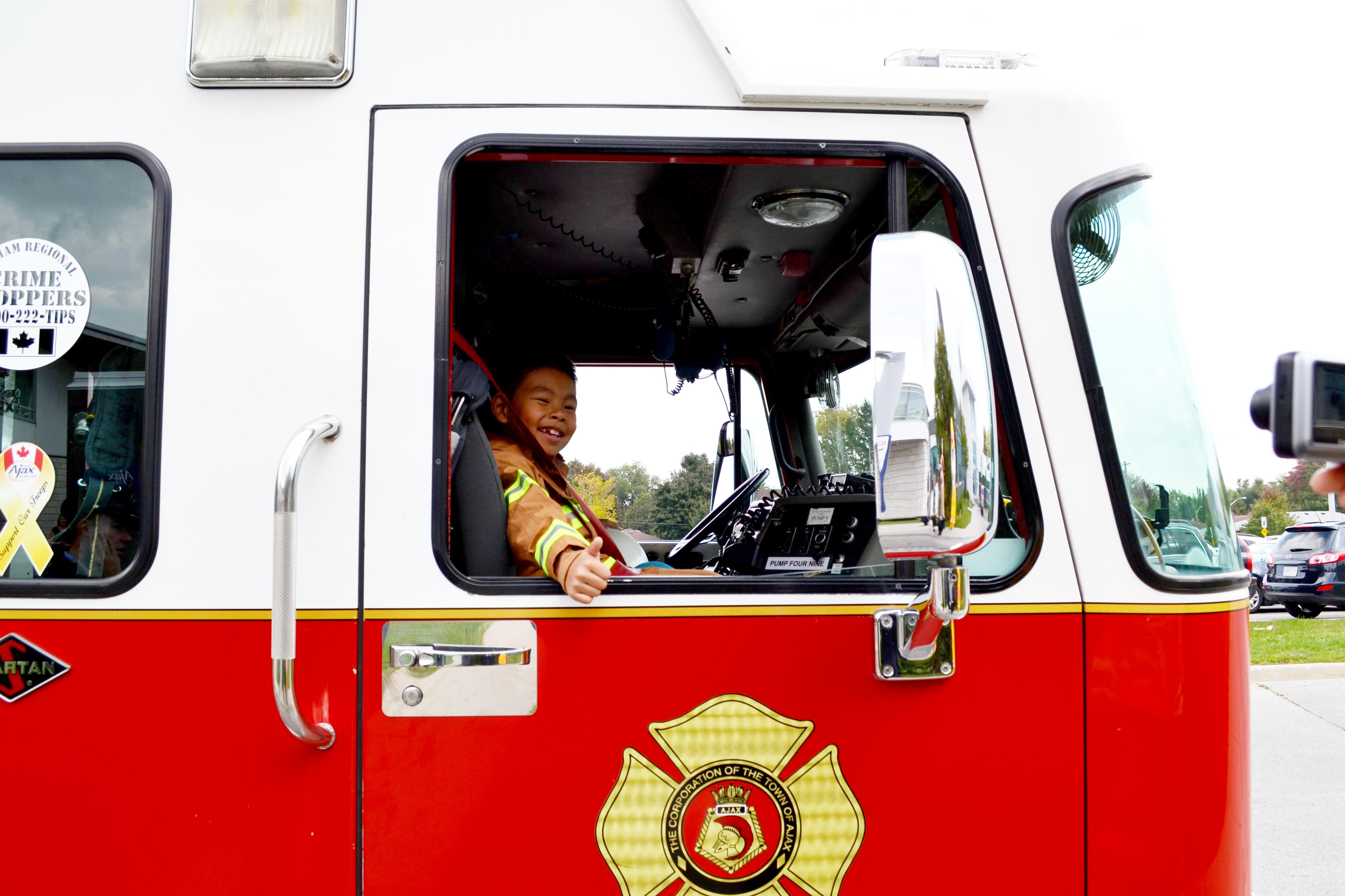 Jayden in fire truck ready for lunch!