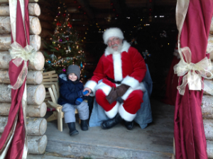 Picture of Child and Santa at the Dalkeith Santa's Village